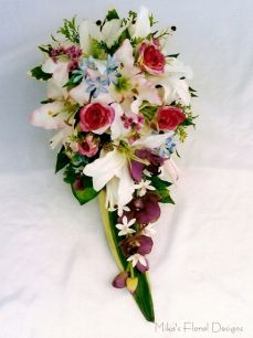 Lily, Rose, Orchid and Geraldton Wax Flower Trailing Bouquet